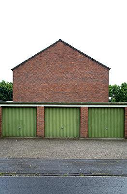 Three garage doors - p3881790 by Ulrike Leyens