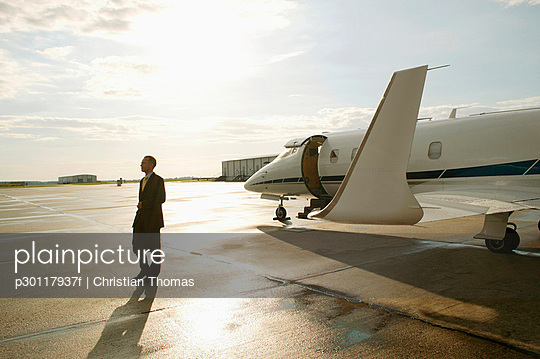 Businessman disembarking from a private airplane
