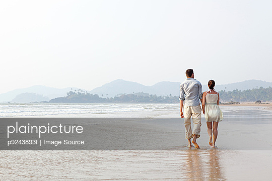 Couple walking in the sea