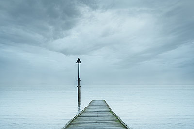wooden jetty into sea - p1280m2073108 by Dave Wall