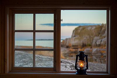 Kerosene lamp on window sill - p312m1192854 by Peter Lyden