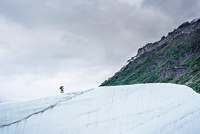 Female hiker on Root Glacier Wrangell St. Elias National Park and Preserve near McCarthy, Alaska - p343m1475637 by Cavan Images