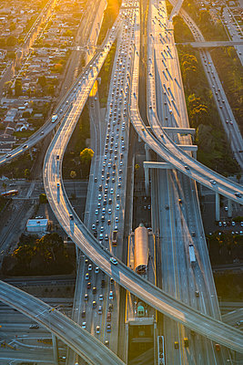 Aerial view of highway interchange in cityscape - p555m1305500 by Chris Sattlberger