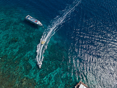 Towable water tube is being pulled by a speedboat - p1108m2090353 by trubavin