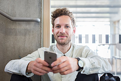 Male student using smartphone - p1284m1452024 by Ritzmann