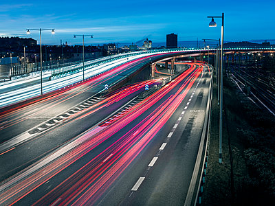 Road traffic at dusk - p312m1211199 by Stefan Isaksson