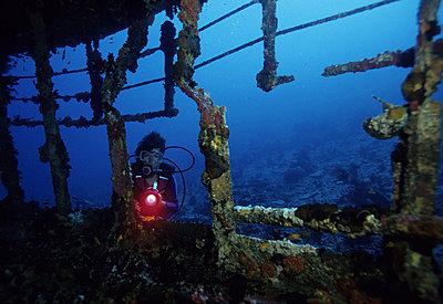 Diver near a sunken boat underwater - p34811545 by Kimmo Hagman