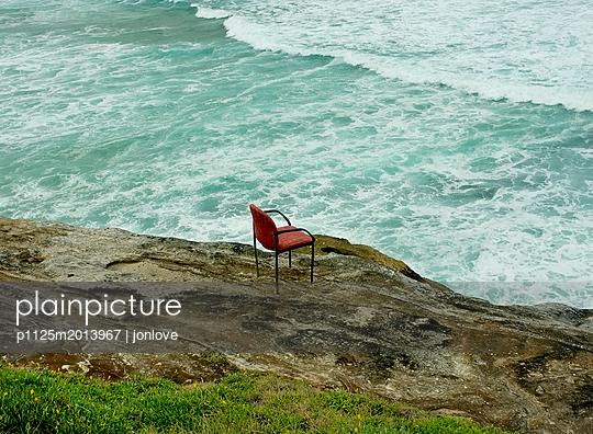 Armchair on ocean cliff  - p1125m2013967 by jonlove