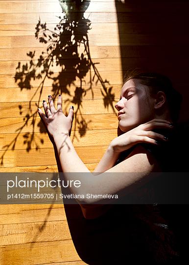 Girl on the wooden floor - p1412m1559705 by Svetlana Shemeleva