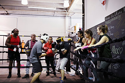 Boxers training in boxing ring in gym - p1192m2033786 by Hero Images