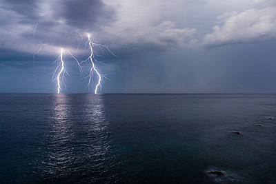 Lightnings on the sea - p1558m2132774 by Luca Casonato