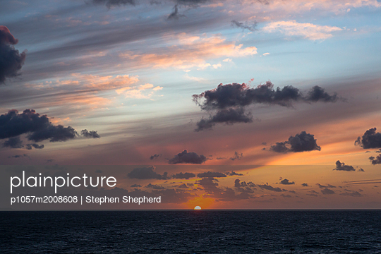 Sunset over the sea with clouds  - p1057m2008608 by Stephen Shepherd