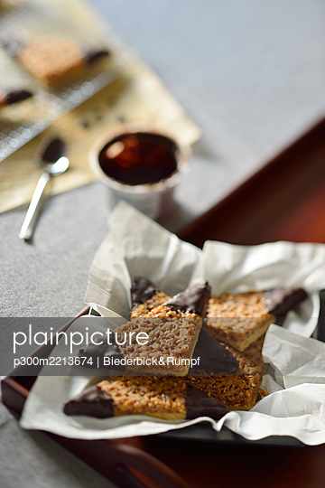 Nut triangles with chocolate icing - p300m2213674 by Biederbick&Rumpf