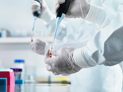 Scientist pipetting liquid in test tube - p429m696202f by Jason Butcher