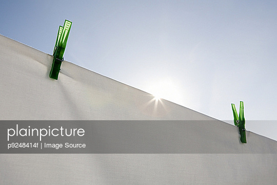 Sheet drying in sunshine - p9248414f by Image Source