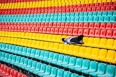 Single man on tribune in football stadium, Friedrich-Ludwig-Jahn-Sportpark - p1093m2193638 by Sven Hagolani