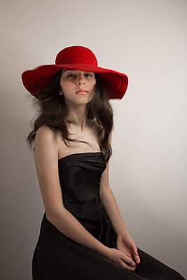 Girl with red hat, portrait - p1623m2283720 by Donatella Loi
