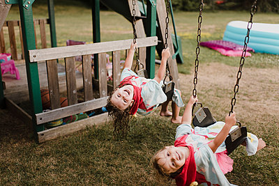 Happy girls with wet hair on a swing - p300m2206984 by Sara Monika