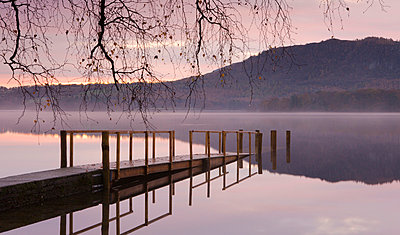 Sunrise over Derwent Water from Hawes End jetty in autumn, Lake District National Park, Cumbria, England, United Kingdom, Europe - p8713047 by Adam Burton