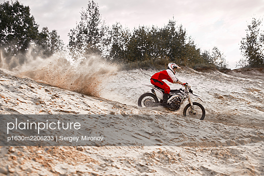 Single motorbiker on motocross racing course - p1630m2206233 by Sergey Mironov