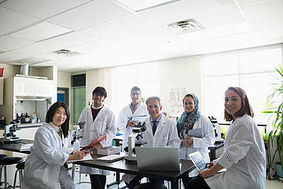 Portrait smiling professor and college students in science laboratory - p1192m1145704 by Hero Images