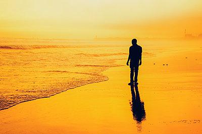 Man on the beach - p1695m2290964 by Dusica Paripovic