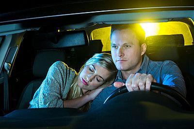 Couple driving at night - p890m886455 by Mielek