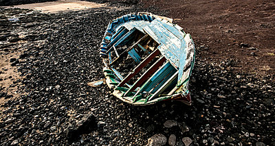 Boat wreck on the beach - p1082m1538981 by Daniel Allan