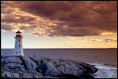 Lighthouse against dramatic sky - p3720448 by Alan Klehr