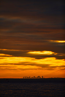 The Boston Skyline At Dramatic Sunset From Gloucester, Massachusetts - p343m1443993 by Josh Campbell