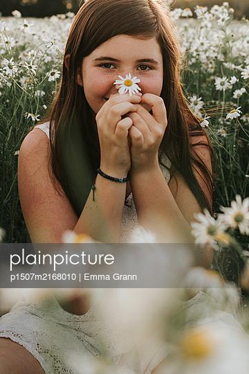 Girl in flower field - p1507m2168010 by Emma Grann