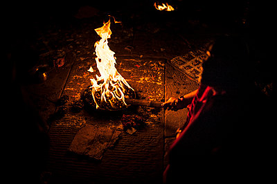 Woman and fire - p1007m1144400 by Tilby Vattard