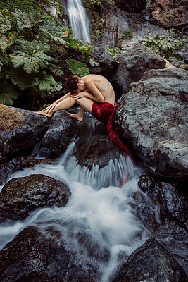 Woman Relaxing by Waterfall - p1262m1083654 by Maryanne Gobble