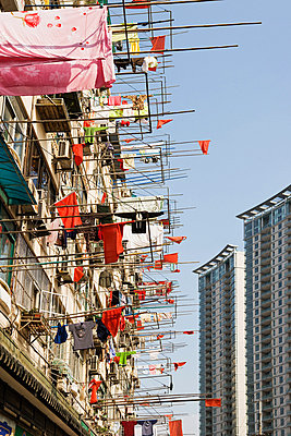 Apartment building with laundry - p9246143f by Image Source