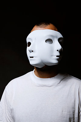 Man with two white masks - p1521m2150072 by Charlotte Zobel