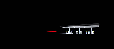 Illuminated gas station at night - p301m1130902f by Paolo Ippolito