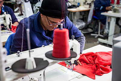 Seamstress working in factory, Cape Town, South Africa - p429m1494376 by Luka Storm