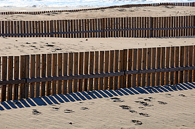Fence on a beach in Andalusia - p7260023 by Katarzyna Zommer
