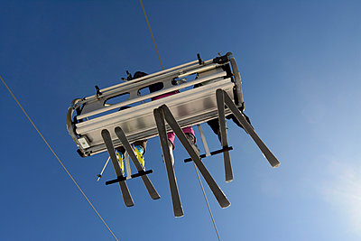 Chairlift with three people - p813m901972 by B.Jaubert