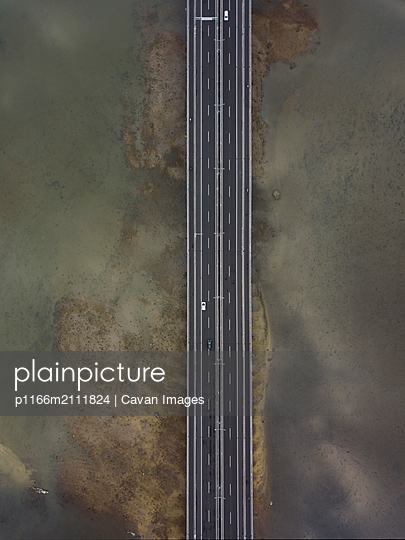 Aerial view of bridge in the sea - p1166m2111824 by Cavan Images