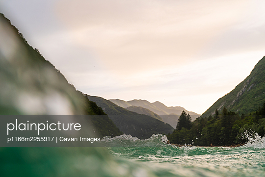 Agitated Soca river water crossing the landscape, Slovenia. - p1166m2255917 by Cavan Images