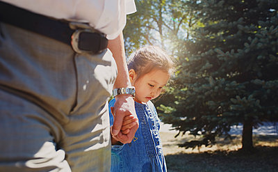 Grandfather holding hands with innocent granddaughter - p1023m1584023 by Arman Zhenikeyev
