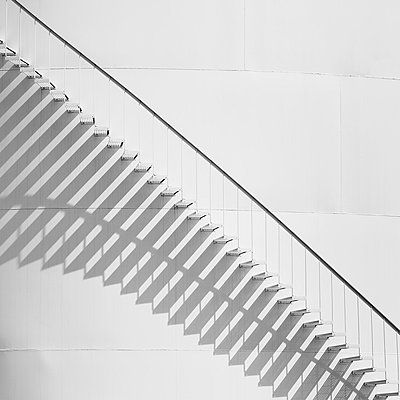 Steps leading up the side of a white storage tank at an oil refinery plant. A pattern of shadows.  - p1100m876025f by Paul Edmondson