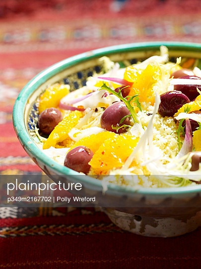 Couscous salad with orange and olives, Morocco, North Africa - p349m2167702 by Polly Wreford