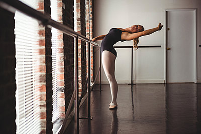 Ballerina practicing ballet dance at barre - p1315m1229623 by Wavebreak