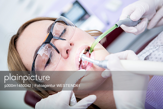 Woman at the dentist receiving root canal treatment