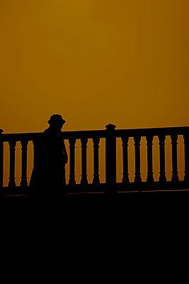 Man on a bridge, Quartier Notre Dame, Paris, France - p1028m1589845 by Jean Marmeisse