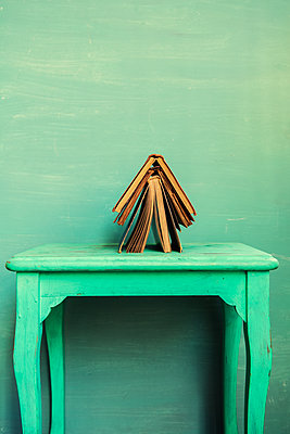 Old books over a green table  - p794m2135048 by Mohamad Itani