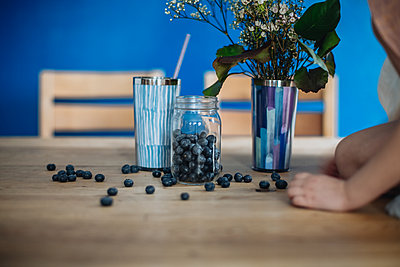 Blueberries on a wooden table - p1414m2044901 by Dasha Pears