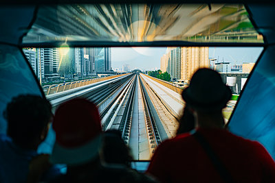 Passengers in automated driverless train - p1053m2027109 by Joern Rynio